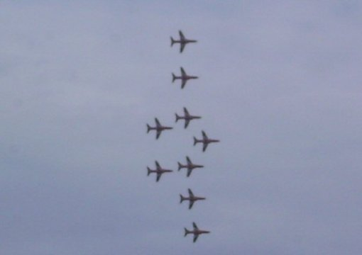 Red Arrows perorming over Lyme Regis